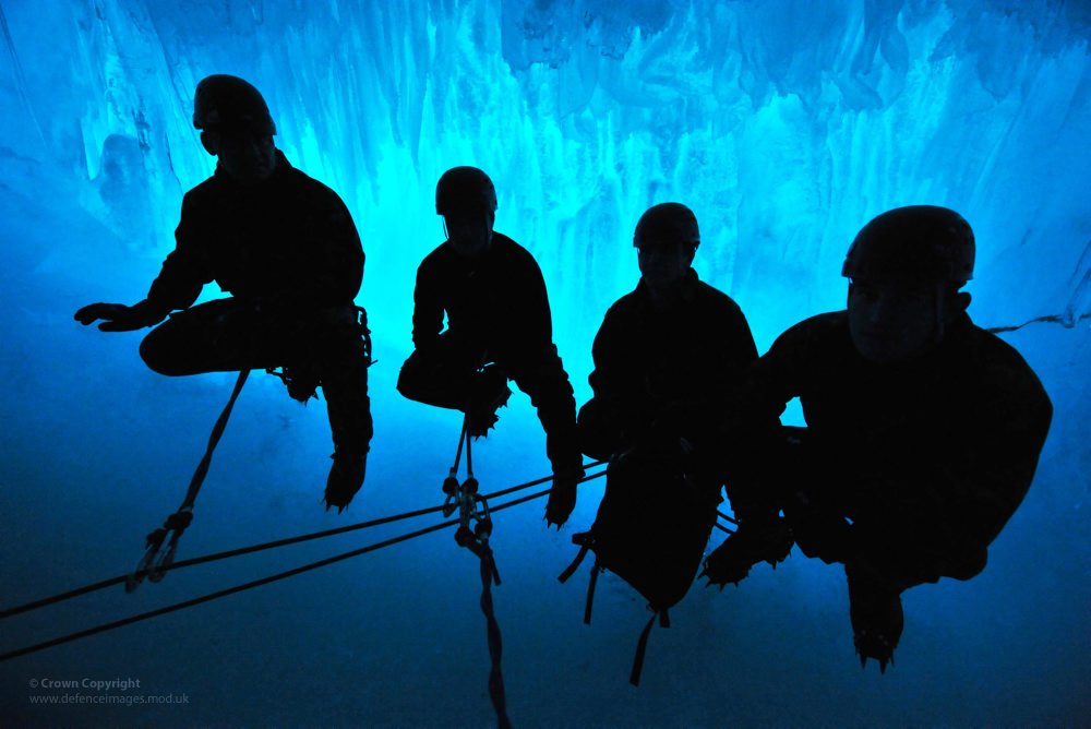Royal Marines Exploring Ice Crevasses in Antarctica