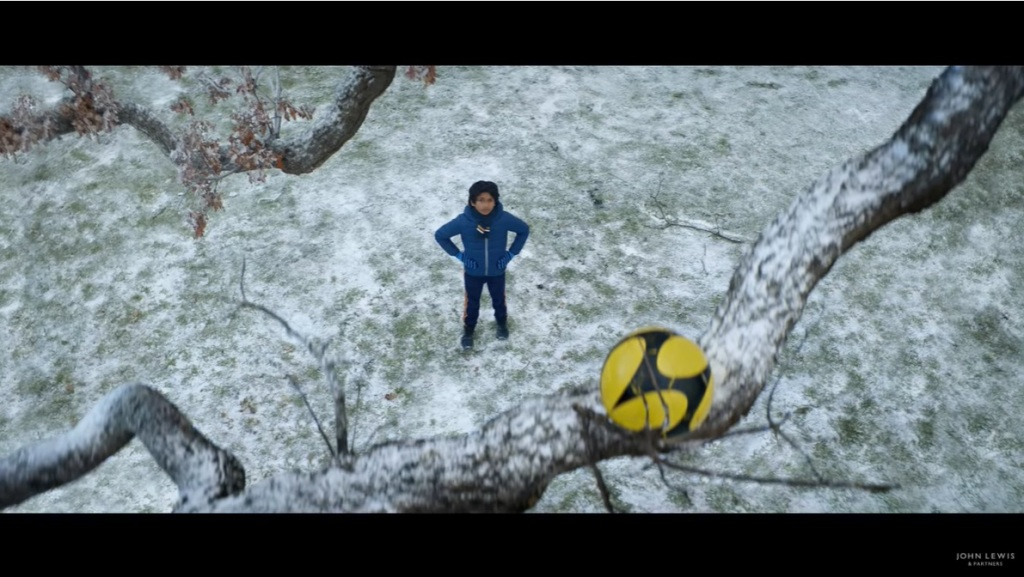 The advert starts with the boy's ball stuck up a tree