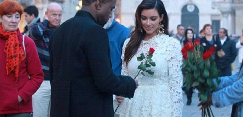 Kim Kardashian and Kanye West - larger